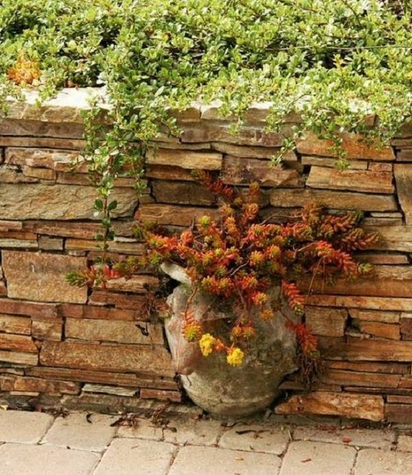 Дизайн клумбы из камня